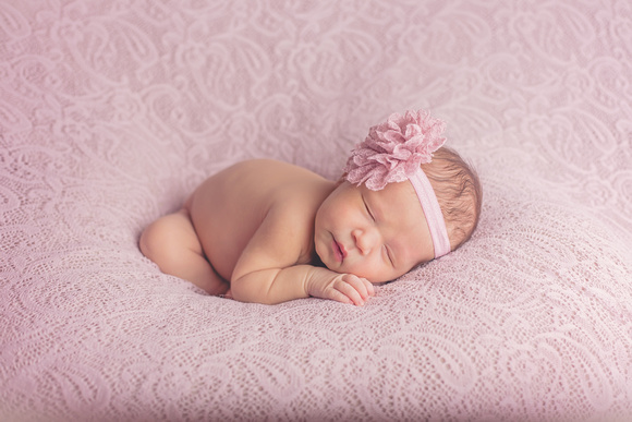 sleeping Newborn in pink lace Louisville Newborn photographer